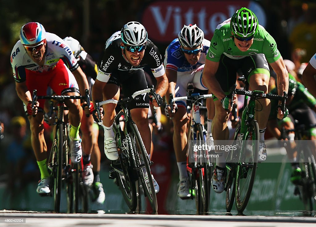 Mark Cavendish (C) of Great Britain and Etixx-Quick Step and Andre Greipel (R) of Germany and Lotto-Soudal sprint for the finish line during stage seven of the 2015 Tour de France, a 190.5km stage between Livarot and Fougeres on July 10, 2015 in Fougeres, France.