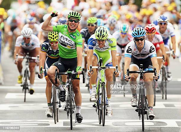 Mark Cavendish of Great Britain and HTC Highroad celebrates winning stage fifteen of the 2011 Tour de France from Limoux to Montpellier on July 17...