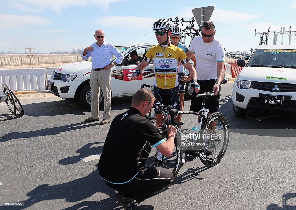 Mark Cavendish of Great Britain and Omega Pharma - Quick Step and has his bike fixed after crashing on stage six of the 2013 Tour of Qatar from Sealine Beach Resort to Doha Corniche on February 8, 2013 in Doha, Qatar. He later went on to win the stage and Overall Classification.