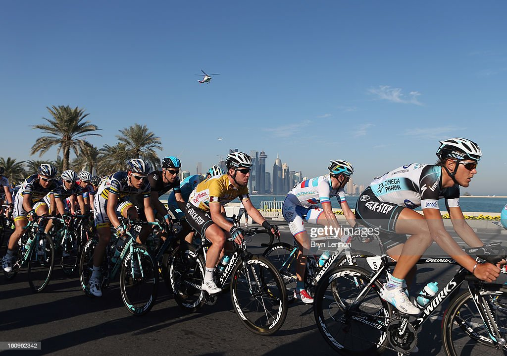 Mark Cavendish of Great Britain and Omega Pharma - Quick Step rides in the peloton prior to winning stage six and the overall classification of the 2013 Tour of Qatar from Sealine Beach Resort to Doha Corniche on February 8, 2013 in Doha, Qatar.