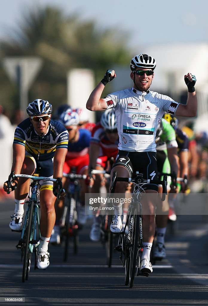Mark Cavendish of Great Britain and Omega Pharma - Quick Step celebrates winning stage four of the Tour of Qatar from Camel Race Track to Al Khor Corniche on February 6, 2013 in Al Khor Corniche, Qatar.
