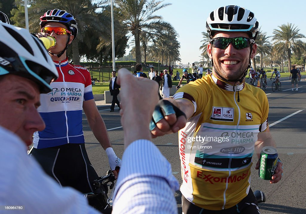 Mark Cavendish of Great Britain and Omega Pharma - Quick Step celebrates with team mates after winning stage six, and the overall classification, of the 2013 Tour of Qatar from Sealine Beach Resort to Doha Corniche on February 8, 2013 in Doha, Qatar.