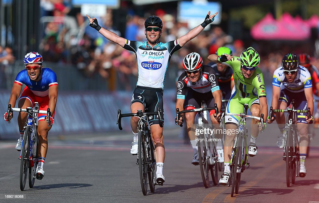 Mark Cavendish of Great Britain and Omega Pharma - Quick-Step celebrates as he crosses the finish line to win stage one of the 2013 Giro d'Italia on May 4, 2013 in Naples, Italy.