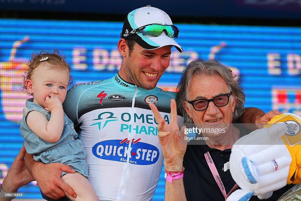 <a gi-track='captionPersonalityLinkClicked' href=/galleries/search?phrase=Mark+Cavendish&family=editorial&specificpeople=684957 ng-click='$event.stopPropagation()'>Mark Cavendish</a> of Great Britain and Omega Pharma - Quick-Step celebrates his stage victory with his daughter Delilah Grace and fashion designer <a gi-track='captionPersonalityLinkClicked' href=/galleries/search?phrase=Paul+Smith+-+Fashion+Designer&family=editorial&specificpeople=5310632 ng-click='$event.stopPropagation()'>Paul Smith</a> on the podium after stage one the 2013 Giro d'Italia on May 4, 2013 in Naples, Italy.
