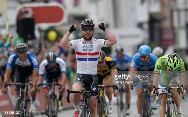 Mark Cavendish of Great Britain and Omega Pharma QuickStep celebrates winning stage seven of the Tour of Britain from Epsom to Guildford on September...