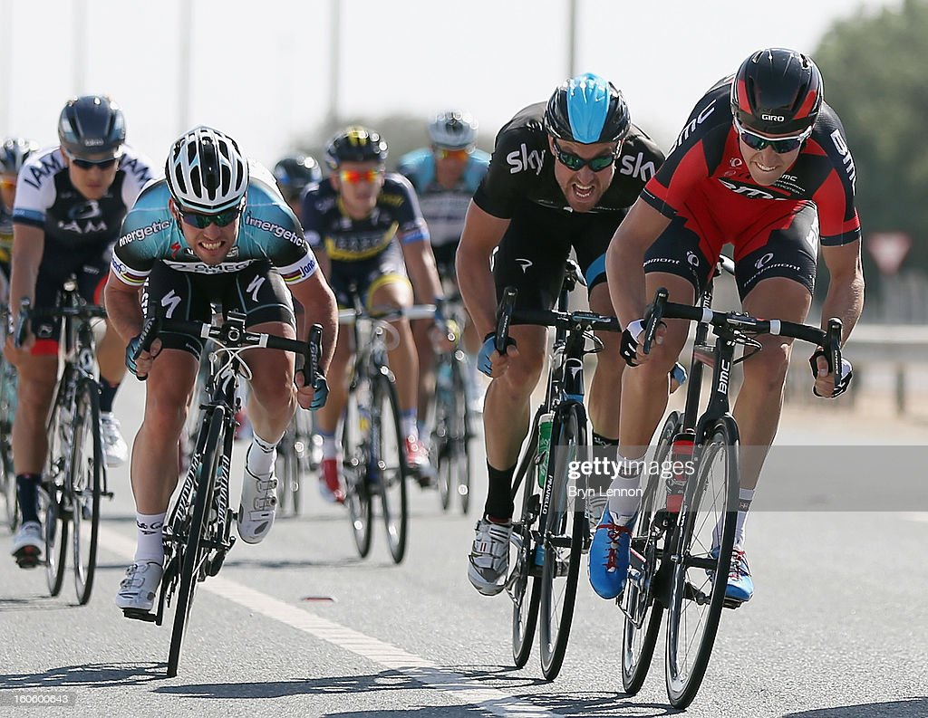 Mark Cavendish of Great Britain and Omega Pharma-Quick Step sprints against Bernhard Eisel of Austria and SKY Procycling and Taylor Phinney of the USA and the BMC Racing Team at an intermediate sprint on stage one of the 2013 Tour of Qatar from Katara Cultural Village to Dukhan Beach on February 3, 2013 in Dukhan Beach, Qatar.