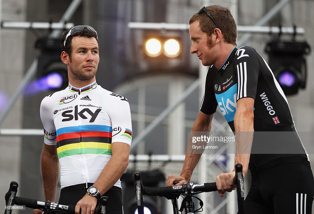 <a gi-track='captionPersonalityLinkClicked' href=/galleries/search?phrase=Mark+Cavendish&family=editorial&specificpeople=684957 ng-click='$event.stopPropagation()'>Mark Cavendish</a> (l) of Great Britain and SKY Procycling chats to team mate <a gi-track='captionPersonalityLinkClicked' href=/galleries/search?phrase=Bradley+Wiggins&family=editorial&specificpeople=182490 ng-click='$event.stopPropagation()'>Bradley Wiggins</a> at the Team Presentation ahead of the 2012 Tour de France at Place Saint-Lambert on June 28, 2012 in Liege, Belgium. (Photo by Bryn Lennon/Getty Images). The 99th Tour de France starts on Saturday with a 6.4km Prologue Time Trail around the streets of Liege.