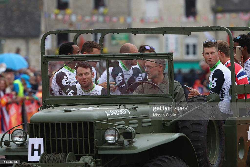 Mark Cavendish of Great Britain and Team Dimension Data arrives in a first world war military vehicle during the team presentations on June 30, 2016 in Sainte-Mere-Eglise, France.