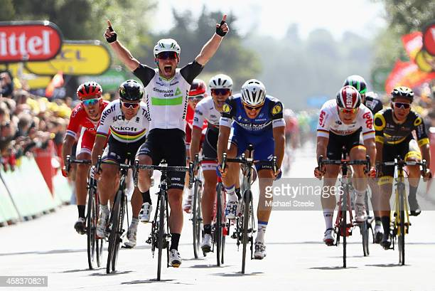 Mark Cavendish of Great Britain and Team Dimension Data celebrates as he crosses the finish line ahead of Marcel Kittel of Germany and EtixxQuick...