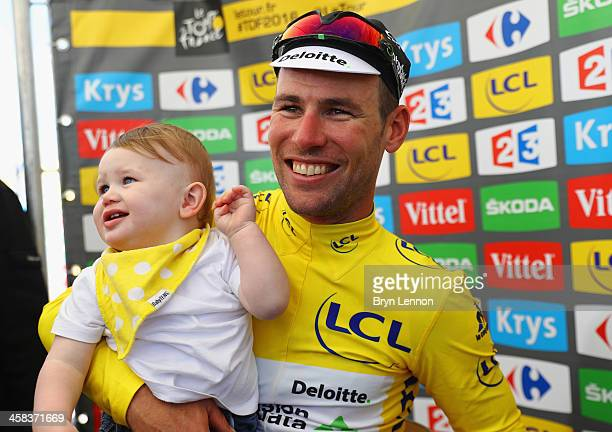 Mark Cavendish of Great Britain and Team Dimension Data celebrates in the yellow jersey with son Frey after victory during Stage One of Le Tour de...