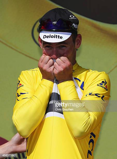 Mark Cavendish of Great Britain and Team Dimension Data kisses the yellow jersey on the podum after victory during Stage One of Le Tour de France...