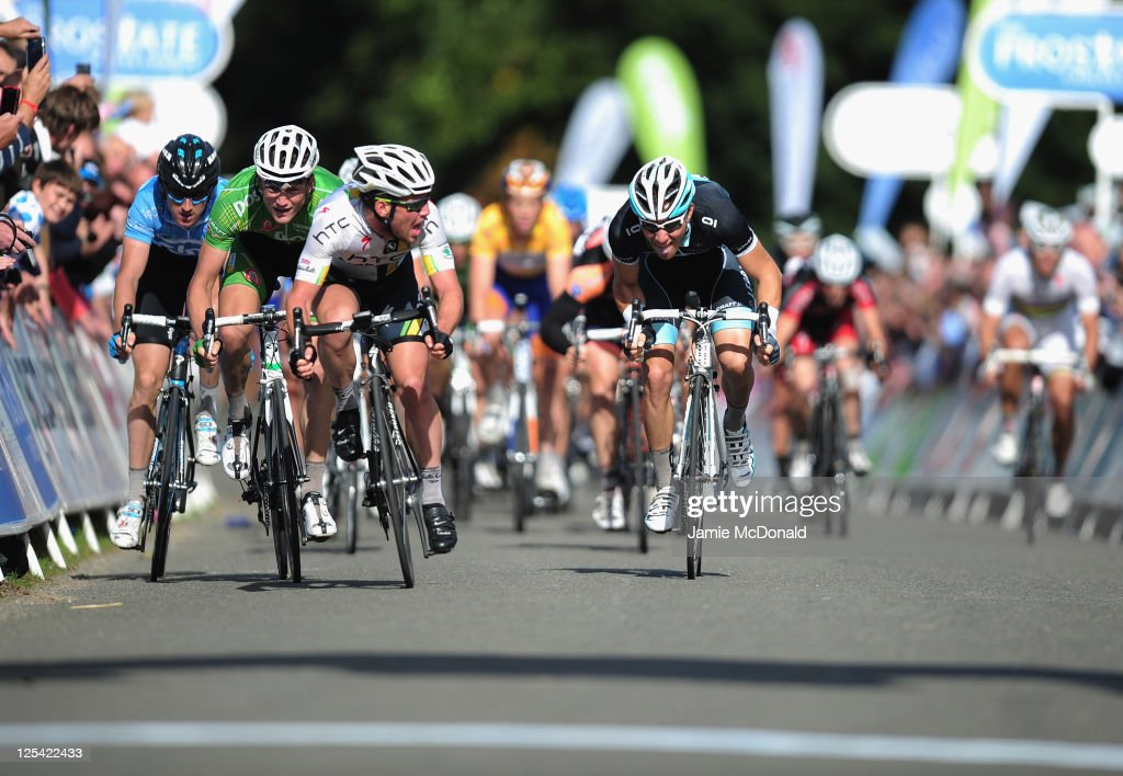 Mark Cavendish of Great Britain and team HTC Highroad leads the sprint peloton during the Tour of Britain Stage Seven between Bury St Edmunds and...