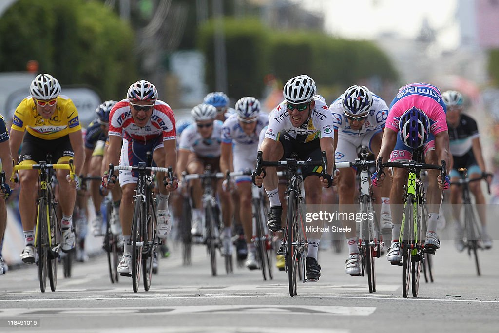 Mark Cavendish (2R) of Great Britain and team HTC Highroad wins his seventeenth stage victory during Stage 7 of the 2011 Tour de France from Le Mans to Chateauroux on July 8, 2011 in Chateauroux, France.