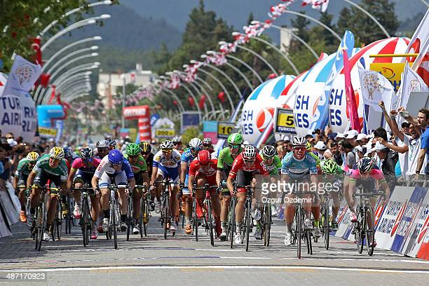 Mark Cavendish of Great Britain and team OmegaPharma Quick Step crosses the finish line to win the 2nd stage of the 50th Presidential Cycling Tour a...