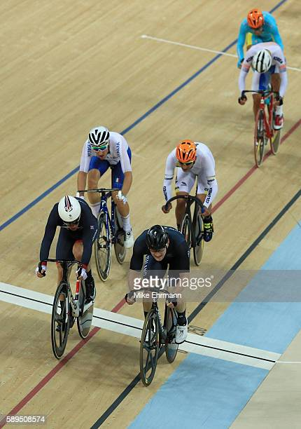 Mark Cavendish of Great Britain Dylan Kennett of New Zealand Elia Viviani of Italy and Fernando Gaviria Rendon of Colombia compete in the Men's...