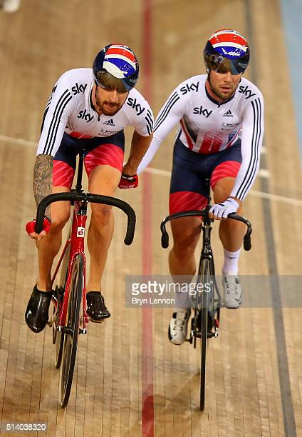 Mark Cavendish of Great Britain hand slings team mate Sir Bradley Wiggins during the Madison Final during Day Five of the UCI Track Cycling World...