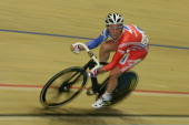 Mark Cavendish of Great Britain powers forward on his way to victory in the Men's Madison Final during the UCI Track Cycling World Championships at...