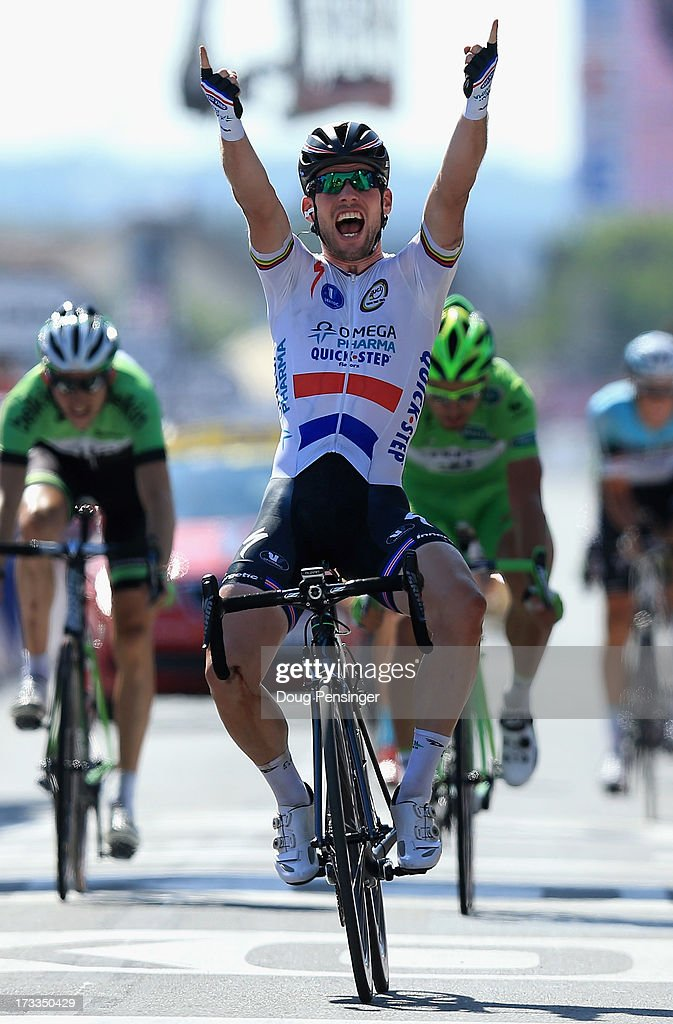 <a gi-track='captionPersonalityLinkClicked' href=/galleries/search?phrase=Mark+Cavendish&family=editorial&specificpeople=684957 ng-click='$event.stopPropagation()'>Mark Cavendish</a> of Great Britain riding for Omega Pharma-Quick Step celebrates as he crosses the finish line to win stage thirteen of the 2013 Tour de France, a 173KM road stage from Tours to Saint-Amand-Montrond on July 12, 2013 in Saint-Amand-Montrond, France.