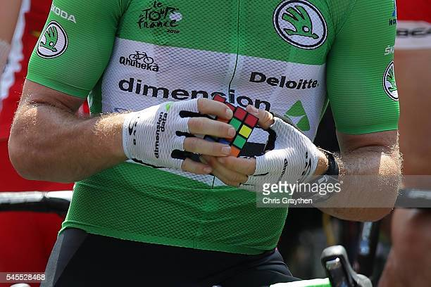 L'ISLEJOURDAIN FRANCE JULY 08 Mark Cavendish of Great Britain riding for Team Dimension Data works on a Rubik's Cube on the start line prior to stage...