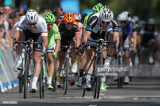 Mark Cavendish of Great Britain riding for the Omega PharmaQuickstep Cycling Team sprints to victory ahead of second place finisher John Degenkolb of...