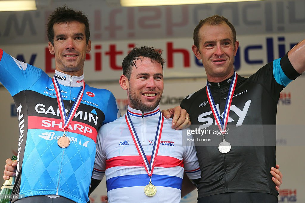 <a gi-track='captionPersonalityLinkClicked' href=/galleries/search?phrase=Mark+Cavendish&family=editorial&specificpeople=684957 ng-click='$event.stopPropagation()'>Mark Cavendish</a> of Omega Pharma-Quickstep celebrates on the podium after winning the 2013 National Mens Road Race Championships, alongside third placed <a gi-track='captionPersonalityLinkClicked' href=/galleries/search?phrase=David+Millar+-+Cyclist&family=editorial&specificpeople=4394499 ng-click='$event.stopPropagation()'>David Millar</a> (L) of Garmin Sharp and second placed <a gi-track='captionPersonalityLinkClicked' href=/galleries/search?phrase=Ian+Stannard&family=editorial&specificpeople=3472614 ng-click='$event.stopPropagation()'>Ian Stannard</a> of SKY Procycling, on June 23, 2013 in Glasgow, Scotland.