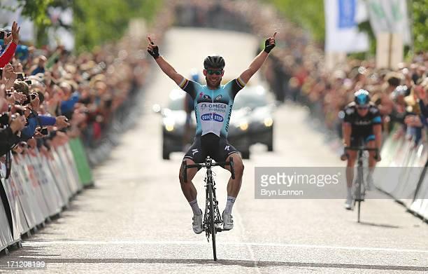 Mark Cavendish of Omega PharmaQuickstep celebrates winning the 2013 National Mens Road Race Championships on June 23 2013 in Glasgow Scotland