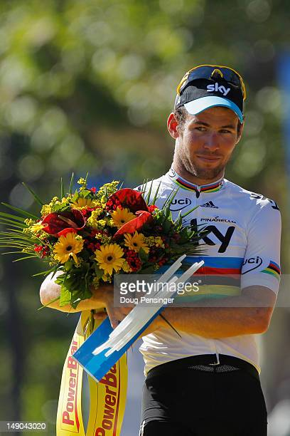 Mark Cavendish of SKY Procycling celebrates his stage win on the podium after the twentieth and final stage of the 2012 Tour de France from...