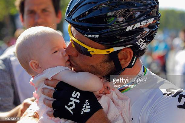Mark Cavendish of SKY Procycling kisses his daughter after he wins the bunch sprint during the twentieth and final stage of the 2012 Tour de France...