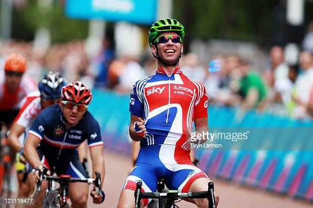 Mark Cavendish of Team GB celebrates winning the LondonSurrey Cycle Classic road race at The Mall on August 14 2011 in London England