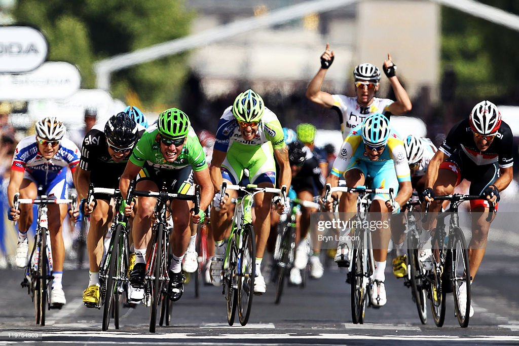 Mark Cavendish (3L) of team HTC sprints to win the final sprint and the green points jersey during the twenty first and final stage of Le Tour de France 2011, from Creteil to the Champs-Elysees in Paris on July 24, 2011 in Paris, France.