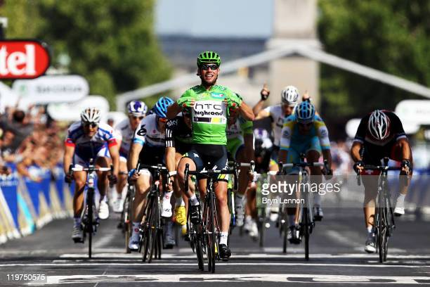 Mark Cavendish of team HTC wins the final sprint and the green points jersey during the twenty first and final stage of Le Tour de France 2011 from...