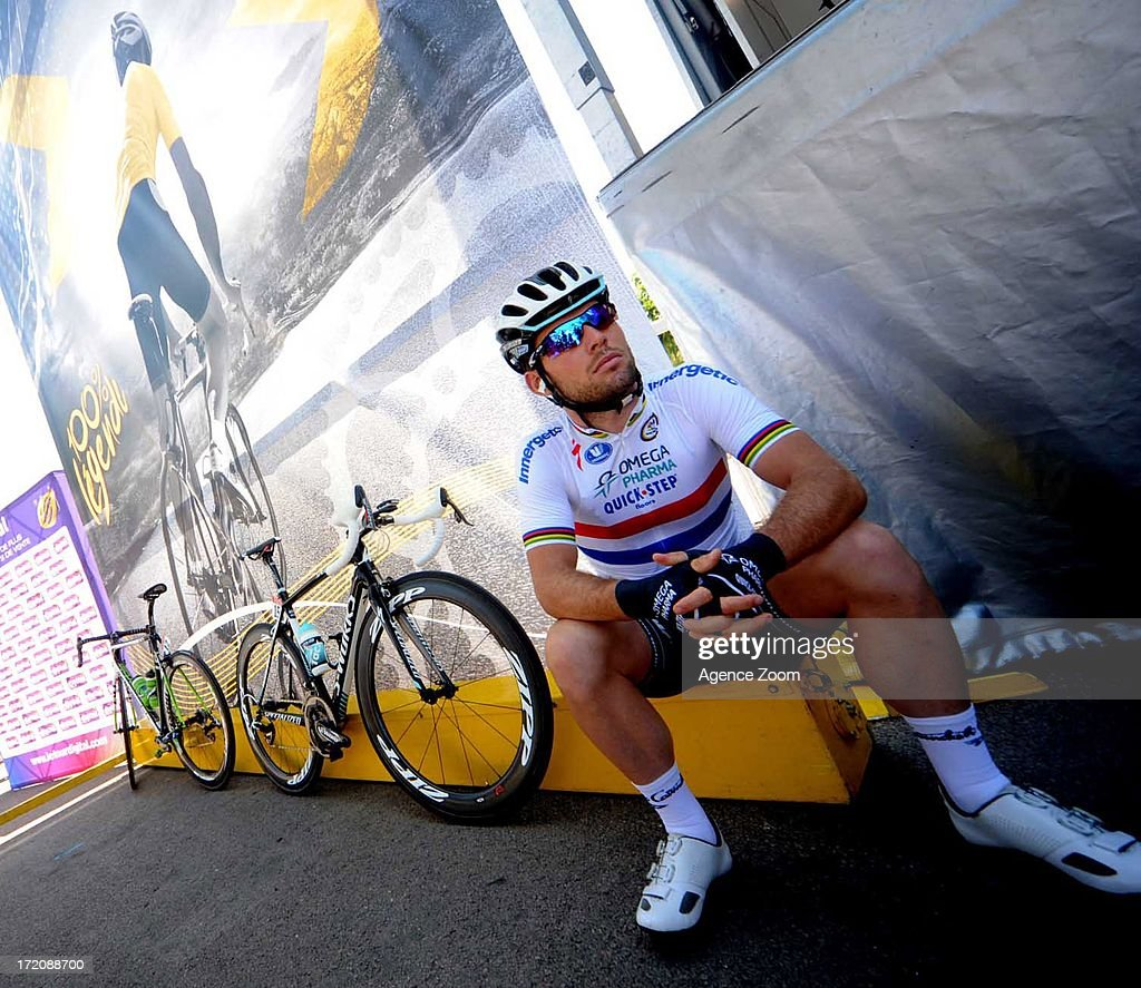 Mark Cavendish of Team Omega Pharma-Quickstep looks on before the start of stage three of the 2013 Tour de France, a 145.5KM road stage from Ajaccio to Calvi, on July 1, 2013 in Ajaccio, France.