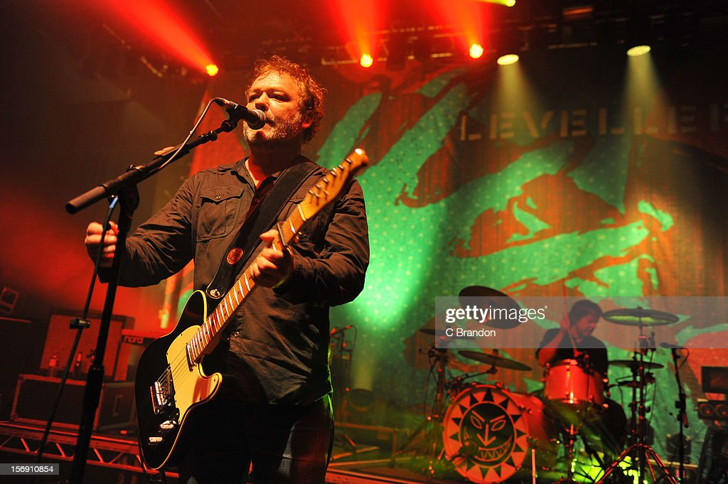 Mark Chadwick and Charlie Heather of The Levellers perform on stage at O2 Shepherd's Bush Empire on November 24, 2012 in London, England.