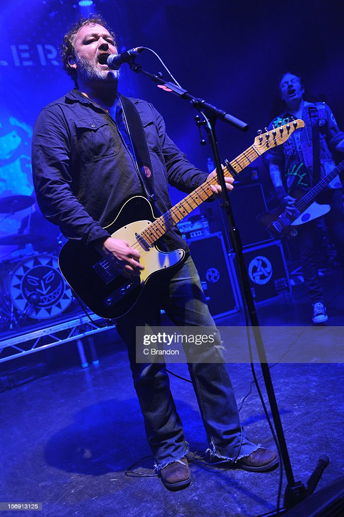 Mark Chadwick and Jeremy Cunningham of The Levellers perform on stage at O2 Shepherd's Bush Empire on November 24, 2012 in London, England.