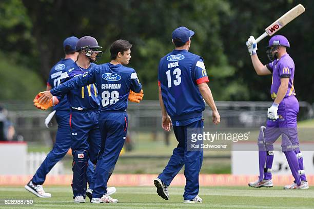 Mark Chapman of the Aces is congratulated by team mates after dismissing Peter Fulton of the Kings during the Super Smash Twenty20 match between the...