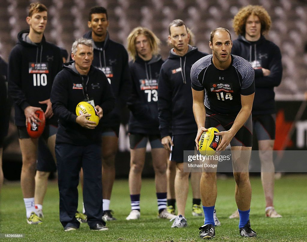 Mark Cisco from the USA kicks the ball during the 2013 AFL Draft Combine at Etihad Stadium on October 3, 2013 in Melbourne, Australia.