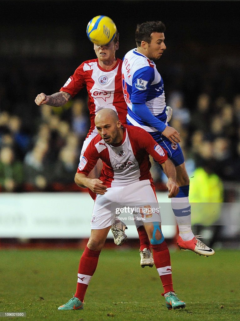 Mark Connolly of Crawley Town wins a header with Adam Le Fondre of Reading and team mate David Hunt of Crawley Town during the FA Cup with Budweiser Third Round match between Crawley Town and Reading at Broadfield Stadium on January 5, 2013 in Crawley, West Sussex.