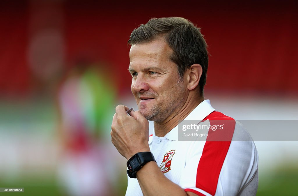 Mark Cooper the Swindon Town manager looks on during the pre season friendly match between Swindon Town and Aston Villa at the County Ground on July...