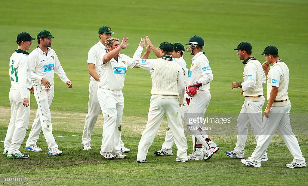 <a gi-track='captionPersonalityLinkClicked' href=/galleries/search?phrase=Mark+Cosgrove&family=editorial&specificpeople=227329 ng-click='$event.stopPropagation()'>Mark Cosgrove</a> of Tasmania celebrates a wicket with team mates during day two of the Sheffield Shield match between the Tasmania Tigers and the Victoria Bushrangers at Blundstone Arena on March 15, 2013 in Hobart, Australia.
