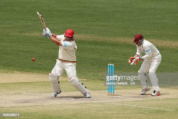 Mark Cosgrove of the Redbacks bats in front of Chris Hartley of the Bulls during day four of the Sheffield Shield match between South Australia and...