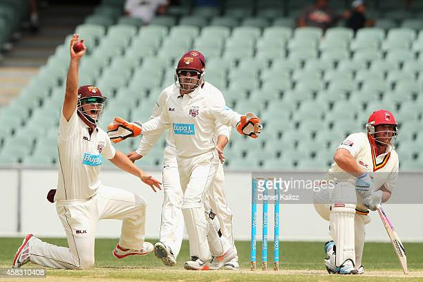Mark Cosgrove of the Redbacks edges the ball and is caught by Ben McDermott of the Bulls during day four of the Sheffield Shield match between South...