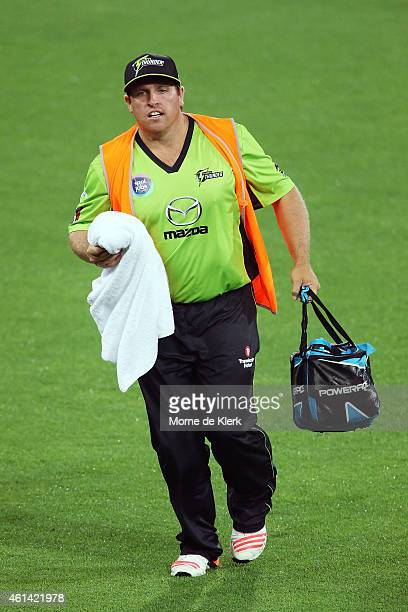 Mark Cosgrove of the Sydney Thunder runs the drinks onto the field during the Big Bash League match between the Adelaide Strikers and Sydney Thunder...