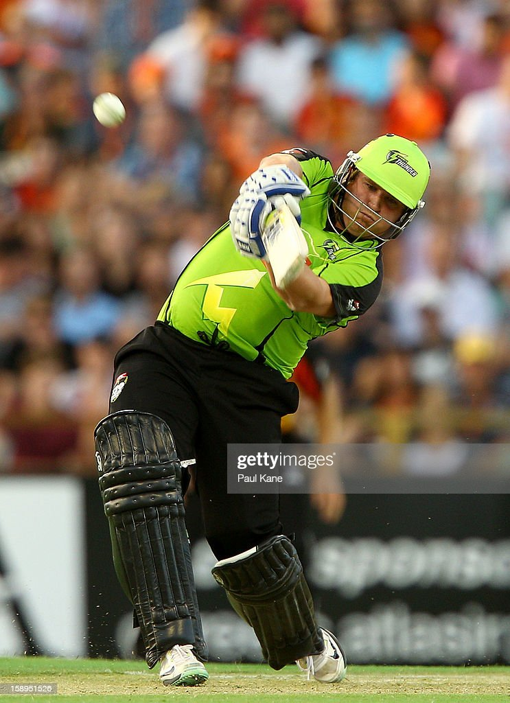 <a gi-track='captionPersonalityLinkClicked' href=/galleries/search?phrase=Mark+Cosgrove&family=editorial&specificpeople=227329 ng-click='$event.stopPropagation()'>Mark Cosgrove</a> of the Thunder hits out during the Big Bash League match between the Perth Scorchers and the Sydney Thunder at WACA on January 4, 2013 in Perth, Australia.