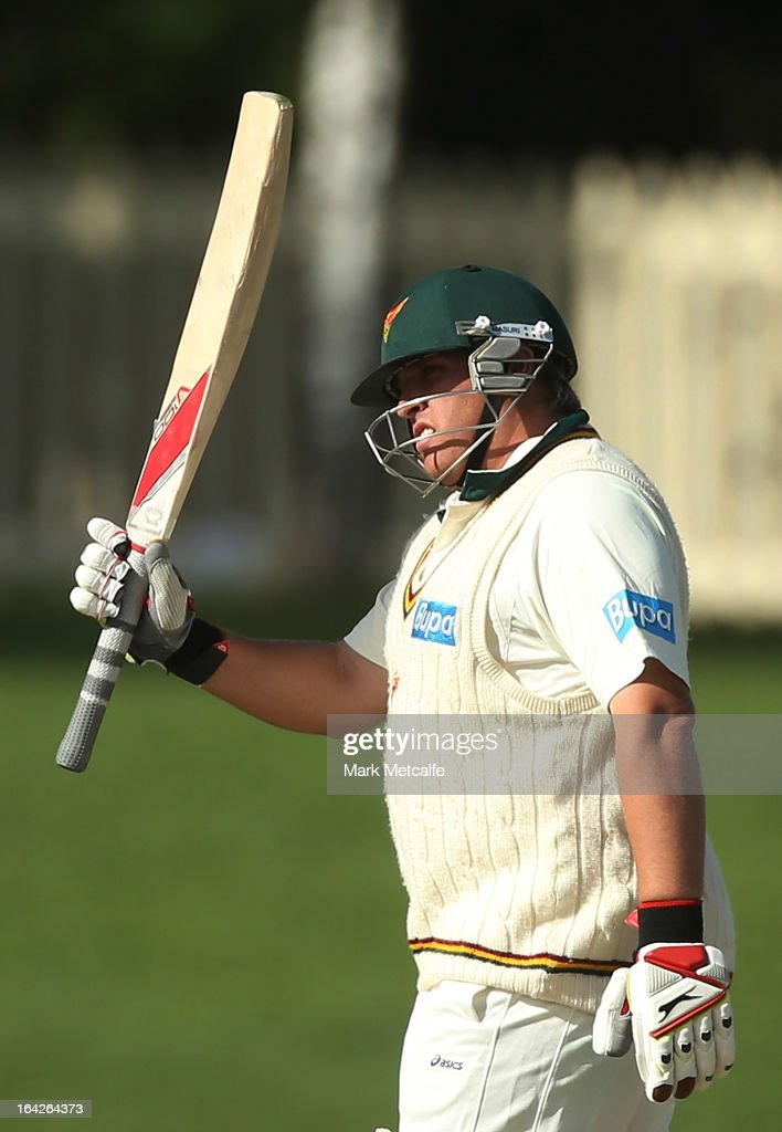 Mark Cosgrove of the Tigers acknowledges the crowd after scoring a half century during day one of the Sheffield Shield final between the Tasmania Tigers and the Queensland Bulls at Blundstone Arena on March 22, 2013 in Hobart, Australia.