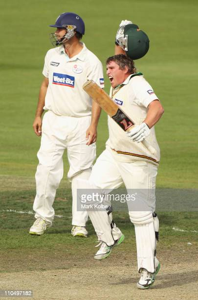 Mark Cosgrove of the Tigers celebrates after hitting the winning runs during day five of the Sheffield Shield final match between the Tasmanian...