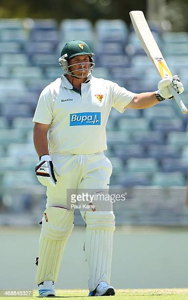 Mark Cosgrove of the Tigers celebrates his half century during day one of the Sheffield Shield match between Western Australia and Tasmania at the...