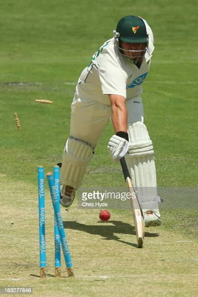 Mark Cosgrove of the Tigers is run out by Greg Moller of the Bulls during day one of the Sheffield Shield match between the Queensland Bulls and the...