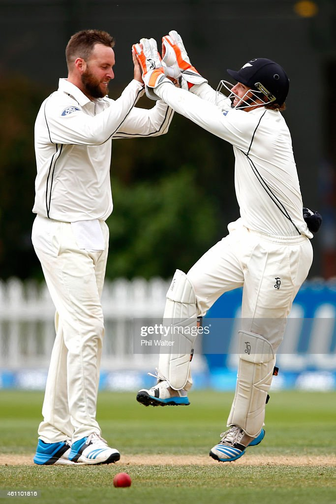 Mark Craig and BJ Watling of New Zealand celebrate the wicket of Suranga Lakmal of Sri Lanka during day five of the Second Test match between New...