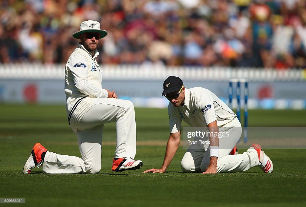 Mark Craig and Tim Southee of New Zealand look on after Mark Craig dropped Steve Smith of Australia during day one of the Test match between New Zealand and Australia at Basin Reserve on February 12, 2016 in Wellington, New Zealand.