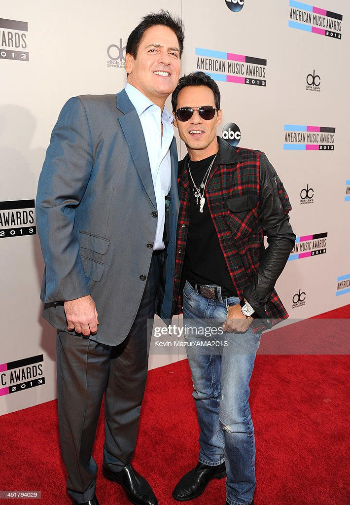 Mark Cuban and Marc Anthony attend the 2013 American Music Awards at Nokia Theatre LA Live on November 24 2013 in Los Angeles California
